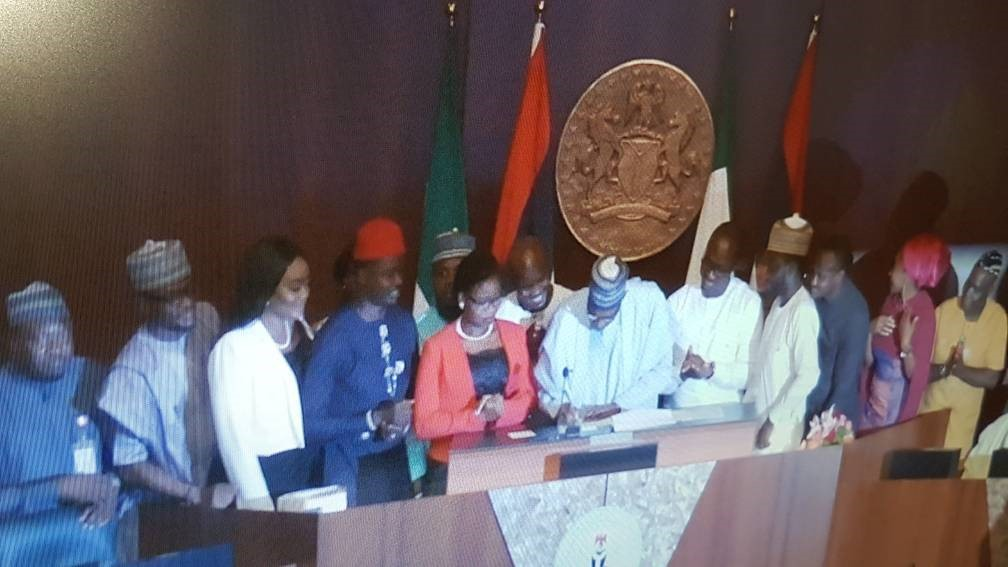 "Buhari signs ""Not Too Young To Run"" bill into law"