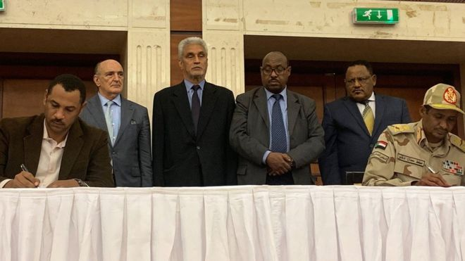 Sudan Military, Civilians Sign Power-Sharing Deal but Odds Still High