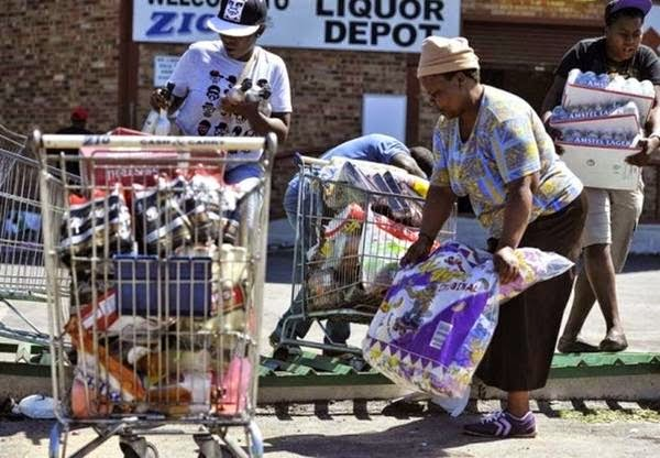 South Africans loot, burn foreigners' shops